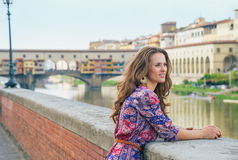 Thoughtful woman on embankment near ponte vecchio Stock Image