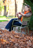 Thoughtful woman enjoying warm autumn day Royalty Free Stock Photography