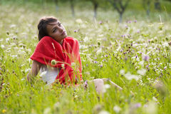 Thoughtful woman in field Stock Photography