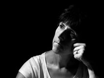 Thoughtful woman, fifties, middle aged. Monochrome portrait. Royalty Free Stock Image
