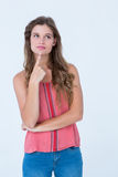 Thoughtful woman with finger on chin Stock Image