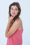 Thoughtful woman with finger on chin Stock Photo