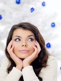 Thoughtful woman in front of a Christmas tree Stock Photo