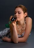 Thoughtful woman with glass of wine. Over dark background Royalty Free Stock Photo