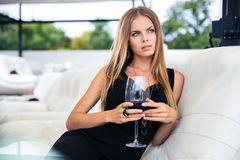 Thoughtful woman with glass of wine Royalty Free Stock Image