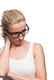 Thoughtful woman in glasses Stock Photo