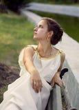 Thoughtful woman in greek dress Stock Photo