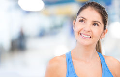 Thoughtful woman at the gym Royalty Free Stock Photos