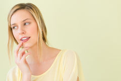 Thoughtful Woman With Hand On Chin Looking Away Stock Photography