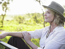 Thoughtful Woman In Hat Against Meadow Stock Photos