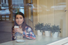 Thoughtful woman having coffee at cafe Royalty Free Stock Photography