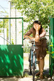 Thoughtful woman with her bicycle Royalty Free Stock Images