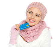 Thoughtful woman holding credit card Stock Photography