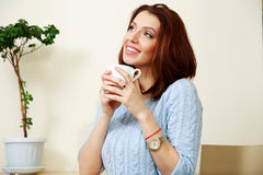 Thoughtful woman holding cup with coffee Royalty Free Stock Images