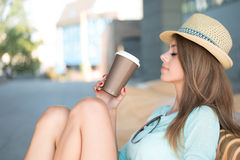 Thoughtful Woman Holding a Cup of Coffee Royalty Free Stock Images