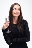 Thoughtful woman holding glass with champagne Royalty Free Stock Photos