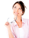 Thoughtful woman holding glasses Stock Photo