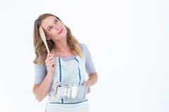 Thoughtful woman holding saucepan Royalty Free Stock Image