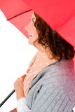 Thoughtful woman holding umbrella Stock Images