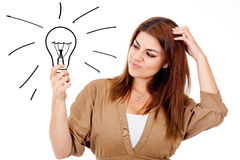 Thoughtful woman with an idea Stock Image