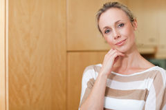 Thoughtful woman in the kitchen Stock Photography