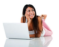 Thoughtful woman with a laptop Stock Photo
