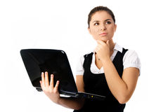 Thoughtful woman with a laptop Stock Photography