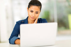 Thoughtful woman laptop Royalty Free Stock Image