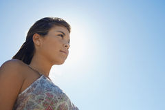 Thoughtful Woman Looking Away Against Clear Sky Stock Photos