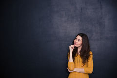 Thoughtful woman looking away at copyspace Royalty Free Stock Photography