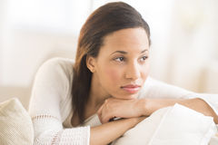 Thoughtful Woman Looking Away At Home Royalty Free Stock Photos