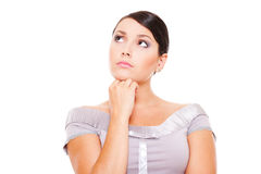 Thoughtful woman looking up Stock Images