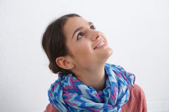Thoughtful woman looking up - isolated over a Stock Photos