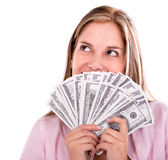 Thoughtful woman with money Stock Image