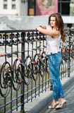 Thoughtful woman near fence with wedding locks. Beautiful thoughtful woman near fence with wedding locks Royalty Free Stock Images
