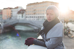 Thoughtful woman outdoors on cold winter day. Stock Images