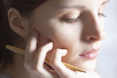 Thoughtful Woman With Pen Resting Hand On Chin Royalty Free Stock Photos