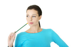 Thoughtful woman with pencil royalty free stock photography