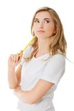 Thoughtful woman with pencil Royalty Free Stock Image