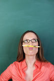 Thoughtful woman with a pencil moustache royalty free stock image