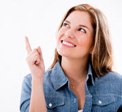 Thoughtful woman pointing Stock Images