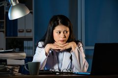 Thoughtful woman practitioner having problem. At work at night. beautiful mixed race asian chinese woman model. medical and health concept Royalty Free Stock Photos