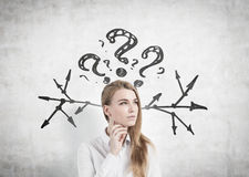 Thoughtful woman, questions and arrows Stock Photos