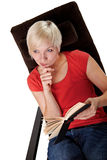 Thoughtful woman while reading a book Royalty Free Stock Photography