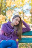 Thoughtful woman relaxing in an autumn park Stock Photo