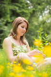 Thoughtful woman relaxing in field Royalty Free Stock Photo