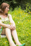 Thoughtful woman relaxing in field Royalty Free Stock Image