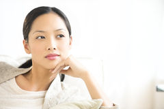 Thoughtful Woman Relaxing At Home Stock Image