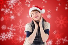 Thoughtful woman in santa hat against digitally generated background. During christmas time Royalty Free Stock Images