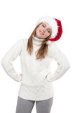 Thoughtful woman in a Santa hat isolated on white background Royalty Free Stock Photography